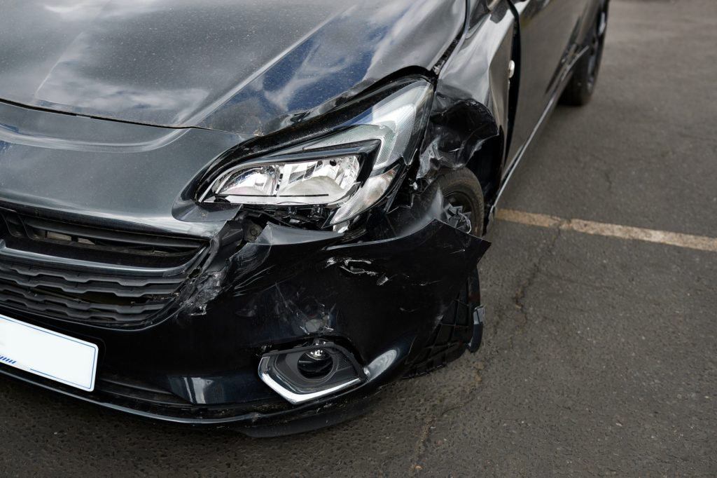 Detail Of Damage To Headlight Of Vehicle In Car Park